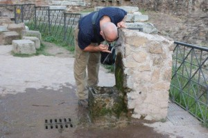 Gregg takes a break at a drinking fountain in the Forum